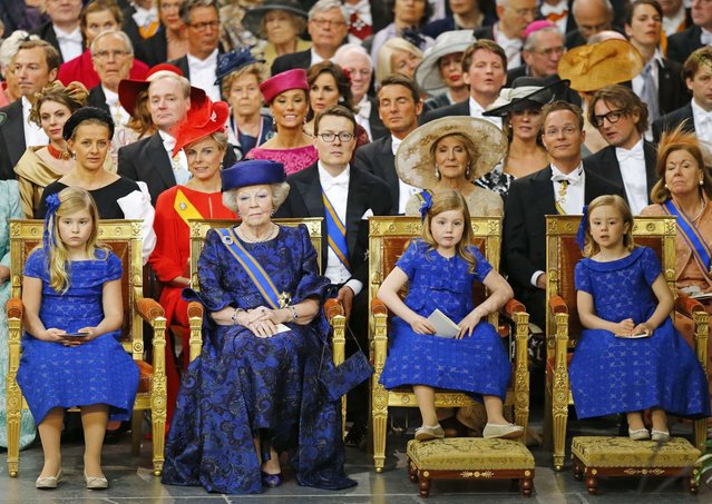 Netherlands Princess Beatrix (2nd L) accompanied by her granddaughters Crown Princess Catharina-Amalia (L) Princess Alexia and Princess Ariane (R) attend the religious crowning cerimonies at the Nieuwe Kerk church in Amsterdam April 30, 2013. The Netherlands is celebrating Queen's Day on Tuesday, which also marks the abdication of Queen Beatrix and the investiture of her eldest son Willem-Alexander. (Photo by Michael Kooren/Reuters)