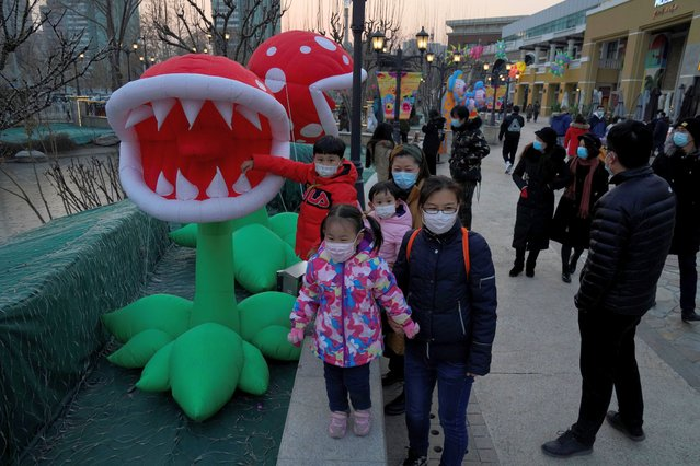 Visitors seen at a mall for a monster-themed festival in Beijing, China, on December 26, 2020. (Photo by Ng Han Guan/AP Photo)
