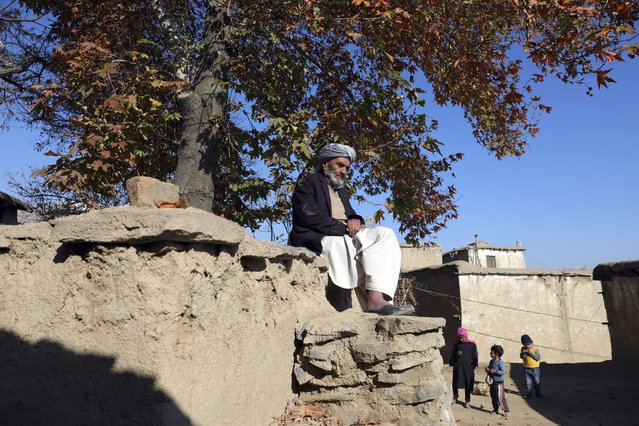 An elderly Afghan man sits in the sun on a cold day in Istalef district of Kabul, Afghanistan, Saturday, November 21, 2020. (Photo by Rahmat Gul/AP Photo)