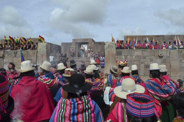 Aymara indigenous people attend a ceremony with Bolivia's President Evo Morales in Tiahuanaco, some 70 km from La Paz, in this January 21, 2015 handout photo provided by the Bolivian Presidency. (Photo by Reuters/ABI/Bolivian Presidency)