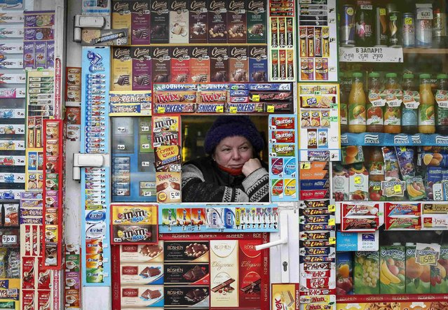 A street vendor waits for customers in central Kiev January 21, 2015. (Photo by Gleb Garanich/Reuters)