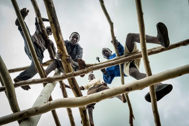 Residents of the village construct a barn to dry tobacco. (Photo by David Levene/The Guardian)