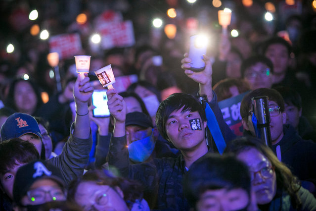 Thousands of South Koreans take to the streets in the city centre to participate in a candlelight rally to demand President Park Geun-Hye to step down on November 12, 2016 in Seoul, South Korea. (Photo by Jean Chung/Getty Images)