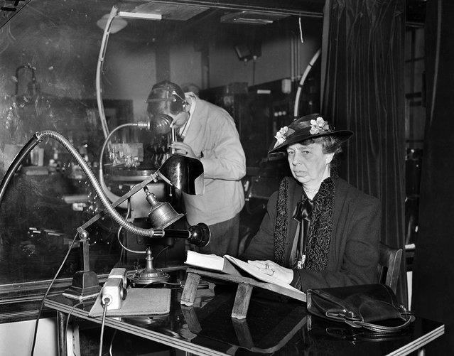 """A talking record is made by First Lady Eleanor Roosevelt in New York, April 27, 1938. At left is recording engineer Leo Phillips. She had read the first chapter of her book """"This Is My Story"""" for the recording and a professional reader will make the rest as a """"Talking Book"""" for the blind. (Photo by AP Photo)"""