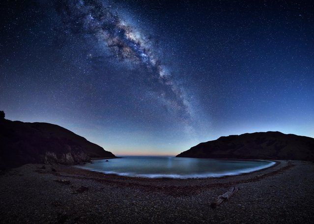 Milky Way stretches across the night sky reflecting on the Cable Bay near Nelson, New Zealand. (Photo by Mark Gee/Astronomy Photographer of the Year 2018)