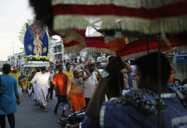 Hindu devotees carry kavadis and pots of milk during their pilgrimage to the Batu Caves temple during Thaipusam in Kuala Lumpur February 2, 2015. (Photo by Olivia Harris/Reuters)