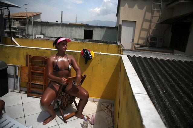 "A woman wearing a masking tape bikini, sunbathes in a terrace to have the perfect bikini mark (""'marquinha"" in Portuguese), at the Erika Bronze spa in Rio de Janeiro, Brazil, November 22, 2016. (Photo by Pilar Olivares/Reuters)"