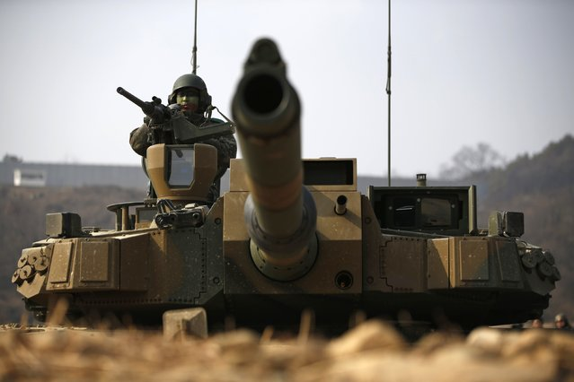 A South Korean army soldier takes position at the army's K-2 tank during an annual live-fire military exercise in Yangpyeong February 11, 2015. (Photo by Kim Hong-Ji/Reuters)