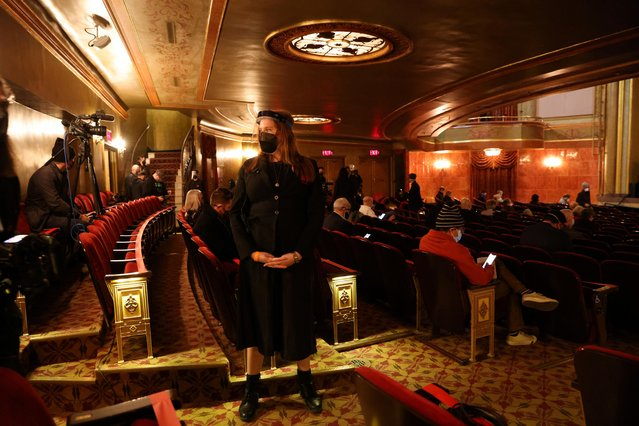 An usher waits to direct audience members to seats wearing a face shield and mask as a precautionary measure at the St. James Theatre for Broadway's first performance since shutting down for Coronavirus (COVID-19) in New York City, U.S., April 3, 2021. (Photo by Caitlin Ochs/Reuters)