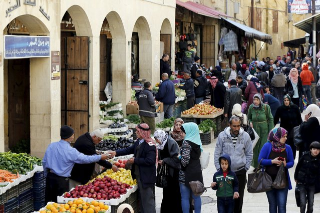 People shop at the Hammam Street Market, on one of the oldest commercial streets in Salt, Jordan, January 5, 2016. (Photo by Muhammad Hamed/Reuters)
