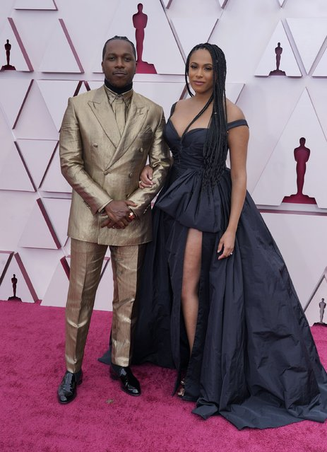Leslie Odom Jr., left, and Nicolette Robinson arrive at the Oscars on Sunday, April 25, 2021, at Union Station in Los Angeles. (Photo by Chris Pizzello/Pool via AP Photo)