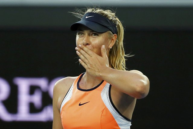 Russia's Maria Sharapova celebrates after winning her first round match against Japan's Nao Hibino at the Australian Open tennis tournament at Melbourne Park, Australia, January 18, 2016. (Photo by Thomas Peter/Reuters)