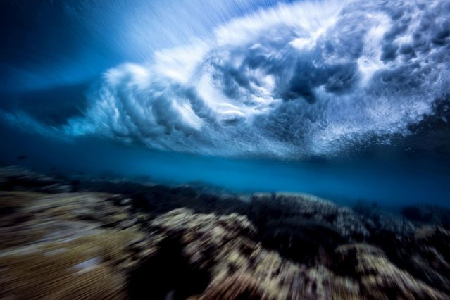 Stunning pictures of waves crashing from underneath. (Photo by Mark Tipple/Caters News Agency)