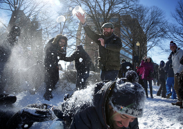 People participate in a snowball fight at Dupont Circle January 24, 2016 in Washington, DC. The blizzard that has brought massive snowfall and a standstill to the East Coast and the Mid Atlantic region has stopped. (Photo by Alex Wong/Getty Images)