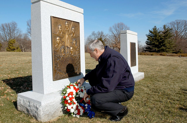 NASA administrator Sean O'Keefe lays a wreath at the Space Shuttle Challenger Memorial January 28, 2003 at Arlington National Cemetery in Virginia. The Challenger exploded shortly after take-off January 28, 1986, killing the entire crew. They are:  Michael Smith, Ronald McNair, Ellison Onizuka, Judith Resnick, Dick Scobee, Greg Jarvis and Christa McAuliffe. O'Keefe also used the occasion to remember the crew of Apollo 1, Roger Chaffee, Ed White and Gus Grissom, who died in a fire on the launch pad on January 27, 1967. (Photo by Bill Ingalls/Getty Images/NASA)