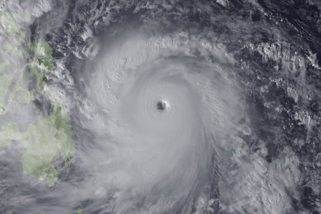 Super Typhoon Haiyan is seen approaching the Philippines in this Japan Meteorological Agency handout image. (Photo by Japan Meteorological Agency/NOAA/Handout via Reuters)