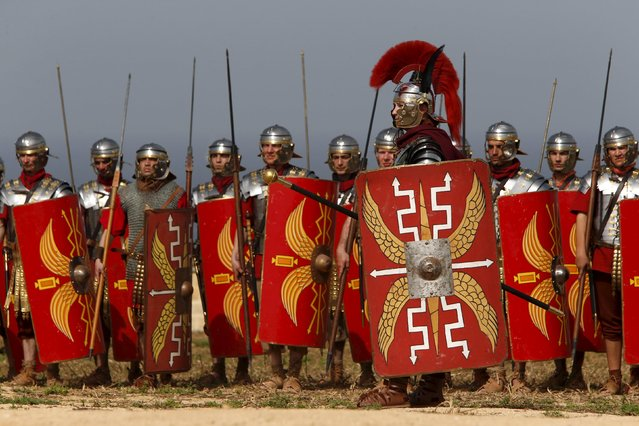 Members of the Legio X Fretensis (Malta) re-enactment group take part in a display of ancient Roman army life at Fort Rinella in Kalkara, outside Valletta, March 22, 2015. (Photo by Darrin Zammit Lupi/Reuters)