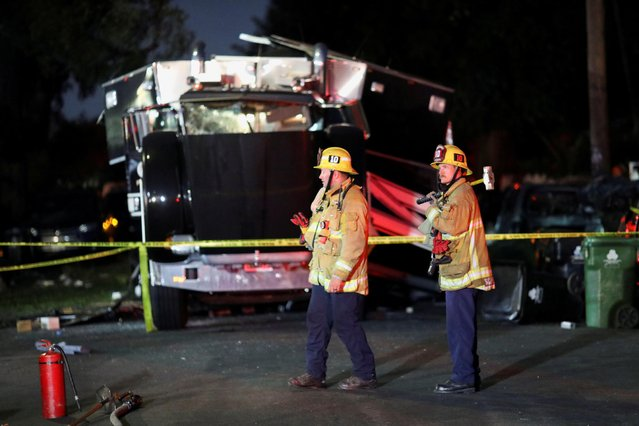A damaged vehicle is seen at the site of an explosion after police attempted to safely detonate illegal fireworks that were seized, in Los Angeles, California, U.S., June 30, 2021. (Photo by David Swanson/Reuters)