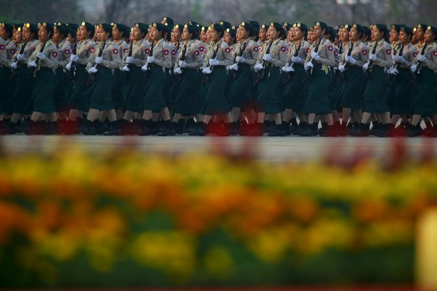 Female soldiers parade to mark the 70th anniversary of Armed Forces Day in Myanmar's capital Naypyitaw, March 27, 2015. The parade commemorates the day when independence hero General Aung San gave the command to the units of the independence army to launch nation-wide resistance against Japanese occupation. (Photo by Soe Zeya Tun/Reuters)