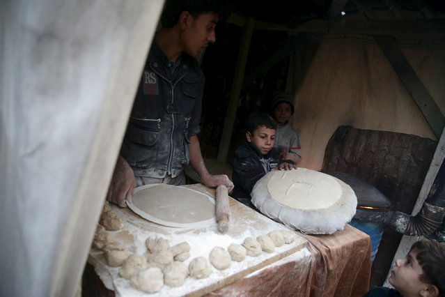 A man makes bread in the town of Douma, eastern Ghouta in Damascus November 5, 2015. (Photo by Bassam Khabieh/Reuters)
