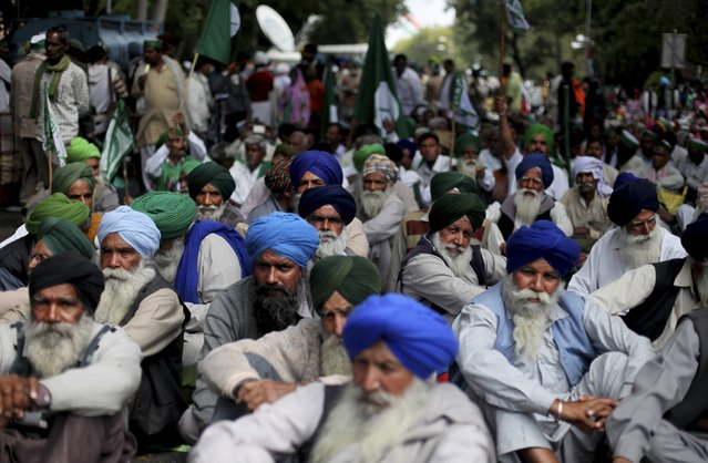 Indian farmers listen to a speaker as they gather near the parliament for a protest against the land acquisition bill, in New Delhi, India, Wednesday, March 18, 2015. The bill currently in parliament proposes to ease rules for acquiring land to facilitate infrastructure projects. (Photo by Altaf Qadri/AP Photo)