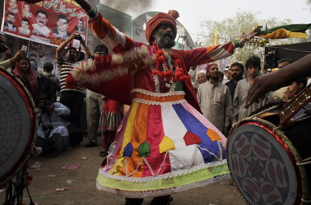 A Pakistani devotee dances at a shrine of Madhu Lal Shah Hussain, a poet also regarded as a Sufi saint, during an annual festival to celebrate him in Lahore, Pakistan, Saturday, March 28, 2015. The annual festival to commemorate Shah Hussain (1538-1599) commonly known as Madhu Lal Hussain started on Saturday with thousands of people expected to visit the shrine. (Photo by K. M Chaudary/AP Photo)