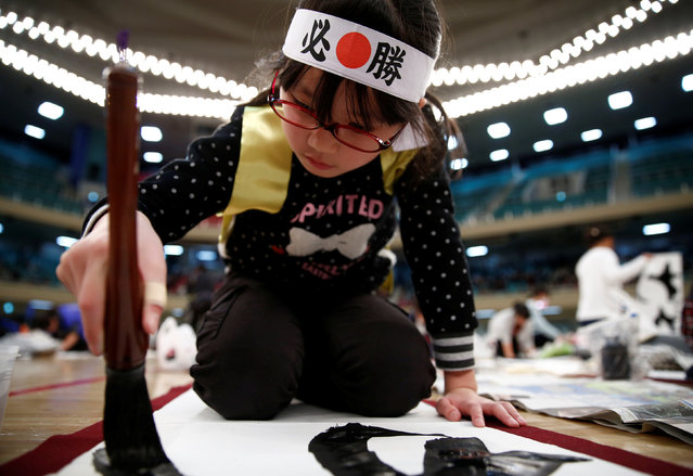 A girl participates in a New Year calligraphy contest in Tokyo, Japan, January 5, 2017. (Photo by Kim Kyung-Hoon/Reuters)