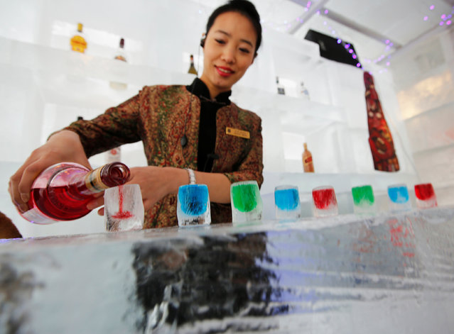 A waitress pours liquor into ice cups on an ice counter during a photo opportunity at the Ice Palace in Shangri-La Hotel in the northern city of Harbin, Heilongjiang province January 6, 2014. (Photo by Kim Kyung-Hoon/Reuters)