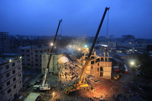 Cranes operated by Bangladeshi Army personnel are pictured at the scene following the April 24 collapse of an eight-storey building in Savar, on the outskirts of Dhaka, on April 29, 2013. (Photo by AFP Photo/STR)