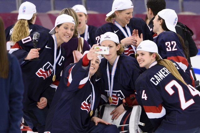 Team USA players pose for a selfie after winning the 2015 IIHF Ice Hockey Women's World Championship gold medal match between USA and Canada at Malmo Isstadion in Malmo, southern Sweden, April 4, 2015. USA won the match by 7-5. (Photo by Claudio Bresciani/Reuters/TT)