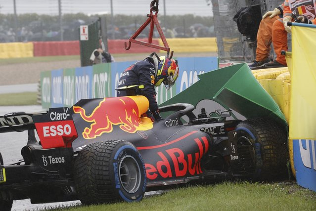 Red Bull driver Sergio Perez of Mexico gets out of his car after crashing on his way to the grid during the Formula One Grand Prix at the Spa-Francorchamps racetrack in Spa, Belgium, Sunday, August 29, 2021. (Photo by Olivier Matthys/AP Photo)