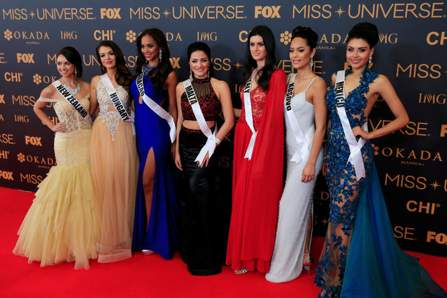 Miss Universe candidates pose for a picture during a red carpet inside a SMX convention in metro Manila, Philippines January 29, 2017. In Photo from L-R: Miss New Zealand Zoey Ivory, Miss Hungary Veronika Bodizs, Miss Curacao Chanelle de Lau, Miss Malta Martha Fenech, Miss Italy Sophia Sergio, Miss Kosovo Camila Barraza and Miss Mexico Kristal Silva. (Photo by Romeo Ranoco/Reuters)
