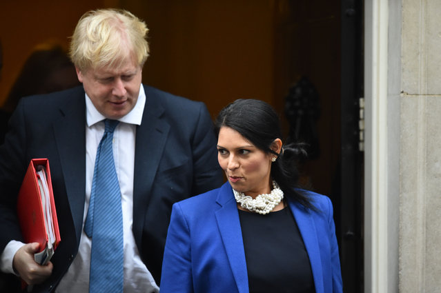British foreign minister Boris Johnson and Britain' s International Development Secretary Priti Patel leave the weekly meeting of the cabinet at 10 Downing Street in central London on January 31, 2017. (Photo by Glyn Kirk/AFP Photo)