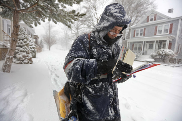 Postman John Gomes fights the wind and heavy snow as he makes his way down Rotch Street in New Bedford, Mass., Thursday, February 9, 2017, as heavy snow sweeps across the region. (Photo by Peter Pereira/Standard Times via AP Photo)