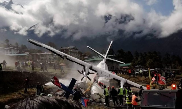 A view of the crash site of a domestic Summit Air aircraft and a helicopter at Lukla Airport, Solukhumbu district, Nepal, 14 April 2019. (Photo by Xinhua News Agency/Rex Features/Shutterstock)