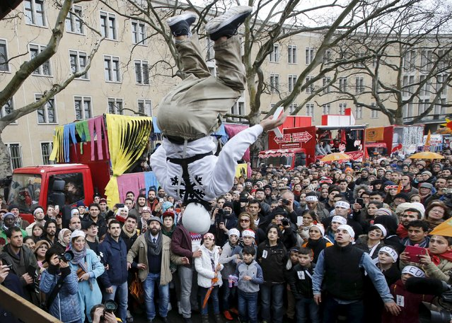 """An artist of the so-called """"Carnival of migrants"""" performs as he takes part in a rally to protest against racism in Berlin, Germany, March 20, 2016. (Photo by Fabrizio Bensch/Reuters)"""