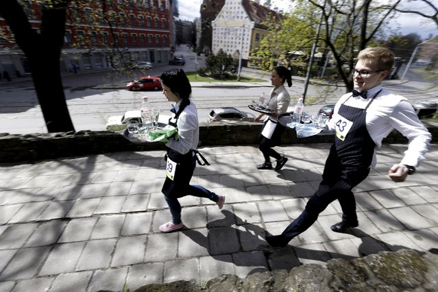"""Waiters compete in the """"Waiters Race"""" in Riga, Latvia May 2, 2015. (Photo by Ints Kalnins/Reuters)"""