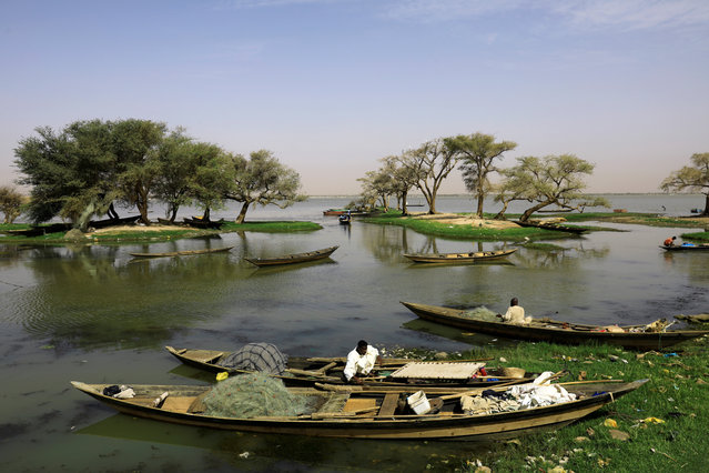 Sudanese fishermen check their boats and nets before they row through the waters of Nile River near Jebel Aulia, Sudan, May 3, 2019. (Photo by Umit Bektas/Reuters)
