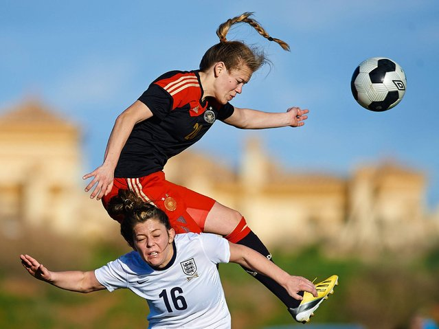 Blanca Bragg (L) of England competes for the ball with Margarita Gidion of Germany during the U-23 friendly match between England and Germany at la Manga Club on March 3, 2014 in La Manga, Spain. (Photo by Manuel Queimadelos Alonso/Getty Images)