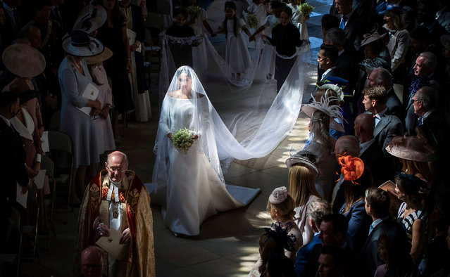 Meghan Markle walks down the aisle in St George's chapel at Windsor Castle during her wedding to Prince Harry on 19 May 2018. (Photo by Danny Lawson/PA Wire)