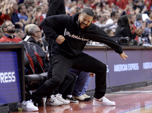Drake reacts to a 3-point basket during the second half of Game 6 of the NBA basketball playoffs Eastern Conference finals between the Toronto Raptors and the Milwaukee Bucks on Saturday, May 25, 2019, in Toronto. (Photo by Nathan Denette/The Canadian Press via AP Photo)