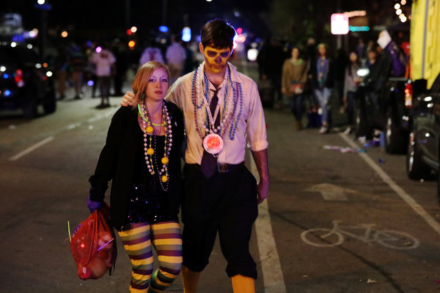People walk away from the scene where a vehicle crashed along the Endymion parade route at Orleans and Carrollton during Mardi Gras in New Orleans, Louisiana U.S., February 25, 2017. (Photo by Shannon Stapleton/Reuters)