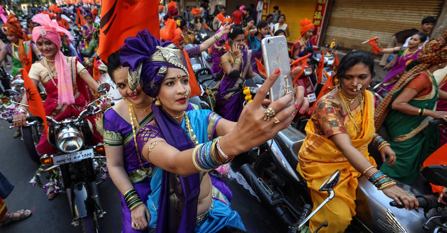 Indian people in traditional clothes participate in the procession to celebrate the Gudi Padwa, Maharashtrian's New Year in Mumbai, India on April 8, 2016. Gudi Padwa is the Hindu festival that falls on the first day of Chaitra month and marks the beginning of the Lunar Calendar, which dictates the dates for all Hindu festivals, also known as Panchang. (Photo by Divyakant Solanki/EPA)