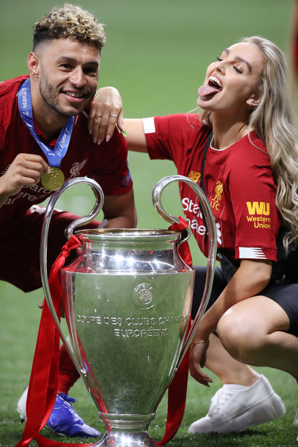 Alex Oxlade-Chamberlain of Liverpool celebrates with Girlfriend Perrie Edwards of Girl group Little Mix after his side won during the UEFA Champions League Final between Tottenham Hotspur and Liverpool at Estadio Wanda Metropolitano on June 01, 2019 in Madrid, Spain. (Photo by Carl Recine/Reuters)