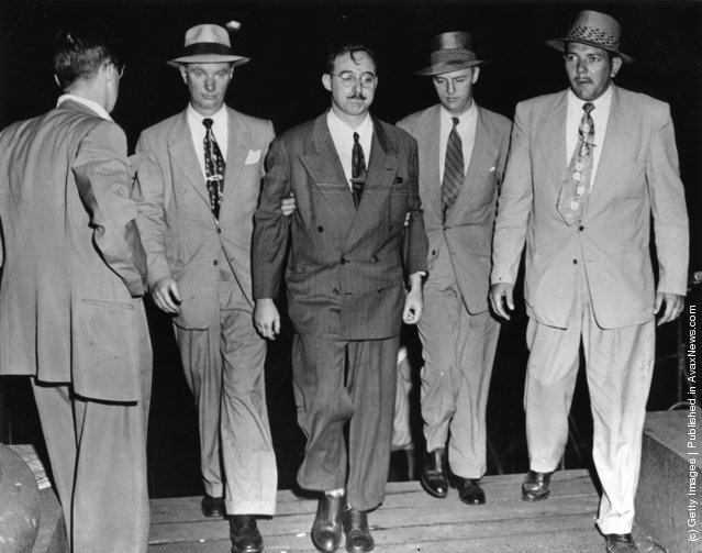 1950: FBI agents escort Julius Rosenberg, a 32 year old engineer (allegedly involved in the Klaus Fuchs-Harry Gold atom bomb spy case), into the FBI building.  According to J  Edgar Hoover he is another important link in the Soviet espionage apparatus