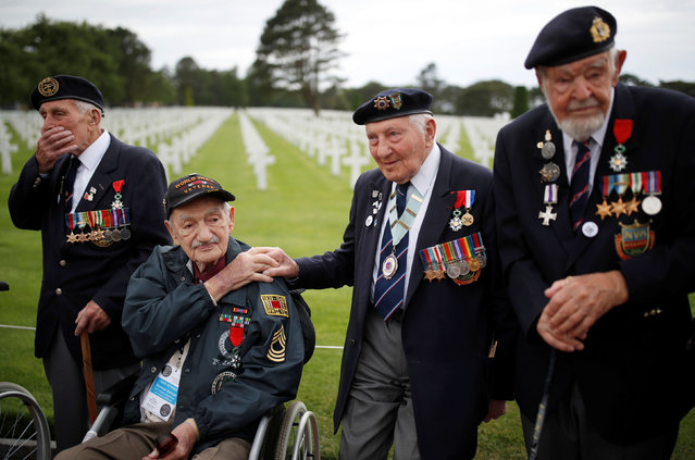 WWII D-Day veterans, including Richard Llewellyn and Mervyn Kersh from Britain and Norman Duncan from the U.S., attend a ceremony at Normandy American Cemetery and Memorial situated above Omaha Beach, as France prepares to commemorate the 75th anniversary of the D-Day, in Colleville-sur-Mer, France, June 4, 2019. (Photo by Christian Hartmann/Reuters)