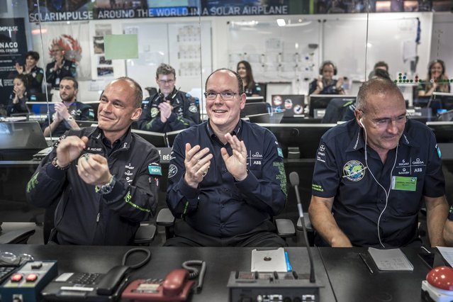 Solar Impulse-CEO and second pilot Bertrant Piccard (L) and Prince Albert of Monaco (C) applaud in the Master Control Center in Monaco May 30, 2015, after the successful take off of Solar Impulse 2 -a solar powered plane- in Nanjing, China. The world's largest solar-powered airplane, Solar Impulse 2, took off from eastern China's Nanjing on Sunday to continue its round-the-world voyage. The Swiss-made plane left Nanjing's Lukou International Airport at 2:39 in the early morning, with former fighter pilot Andre Borschberg at the controls alone for the entire 8,200-kilometer flight from Nanjing to Hawaii, the toughest leg of its marathon adventure.   REUTERS/Solar Impulse/Handout via Reuters