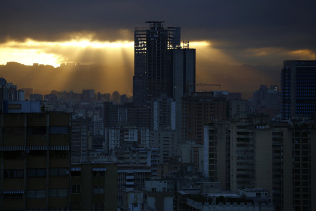 """A skyscraper known as the """"Tower of David"""" is seen in Caracas January 31, 2014. It boasts a helicopter landing pad, glorious views of the Avila mountain range, and large balconies for weekend barbecues. (Photo by Jorge Silva/Reuters)"""