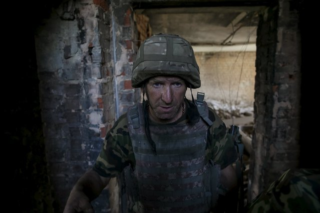 """A member of the Ukrainian armed forces is seen at his position in the town of Maryinka, eastern Ukraine, June 5, 2015. Ukraine's president told his military on Thursday to prepare for a possible """"full-scale invasion"""" by Russia all along their joint border, a day after the worst fighting with Russian-backed separatists in months.  REUTERS/Gleb Garanich"""