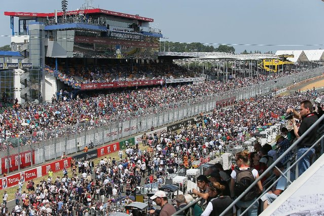 People and fans waiting for the start of the 83rd 24-hour Le Mans endurance race, in Le Mans, western France, Saturday, June 13, 2015. (AP Photo/David Vincent)